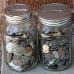 Regular and wide mouth stainless steel coin slot bank lids on Ball quart jars
