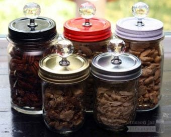 5 colors of crystal knob canister lids on jars of nuts