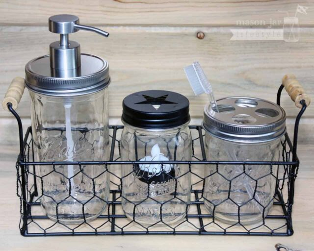 Three jar caddy with soap pump, toothbrush holder, and tea light candle holder in Ball and Kerr Mason jars