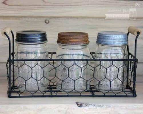 Three jar caddy with antique pint jars and decorative lids