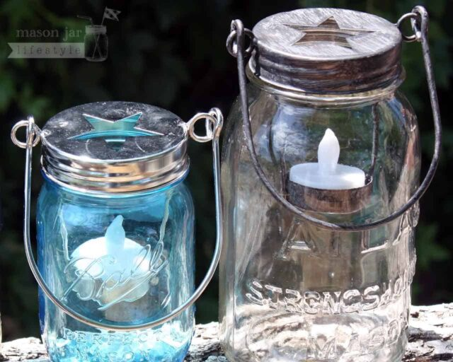 Two colors of star tea light candle holders with handles on Ball and Atlas Mason jars
