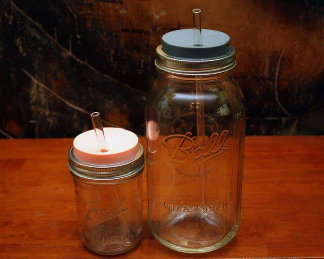 Extra long thick glass straw in half gallon 64oz Mason jar and medium glass straw in pint 16oz Mason jar