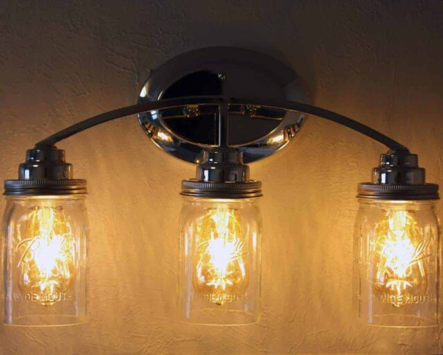 Light fixture with three quart open bottom Ball Mason jars, wide mouth lighting lids, and LED Edison bulbs
