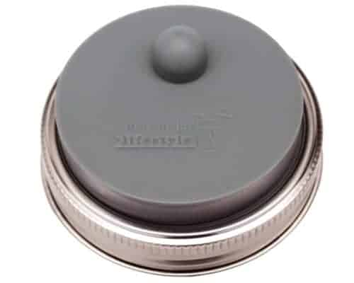 Charcoal gray silicone fermentation valve lid with stainless steel band for lacto fermenting in wide mouth Mason jars
