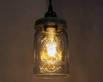 Ball wide mouth quart Mason jar pendant light full kit with hand cut jar, lid, on/off switch, and wall plug - bulb on
