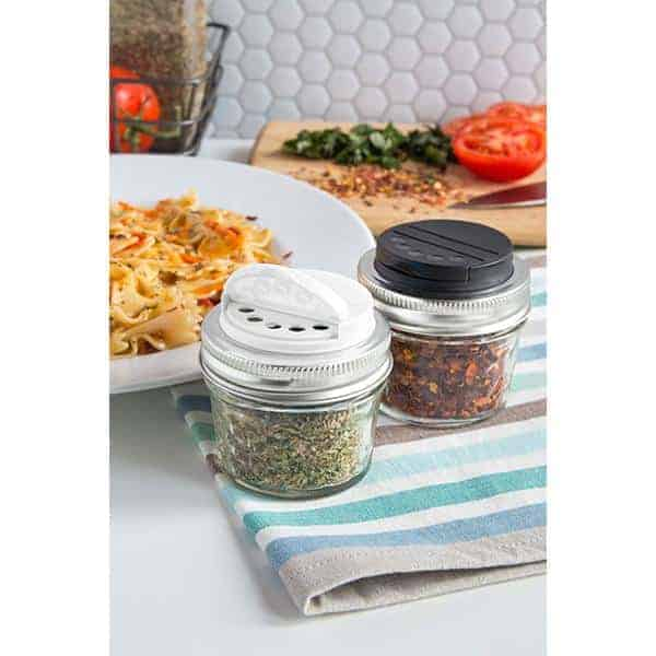 Jarware black and white spice lids for regular mouth Mason jars in kitchen