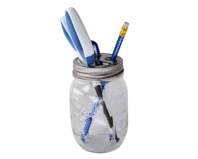 Toothbrush holder lid on regular mouth Ball pint jar with pen, pencil, and scissors