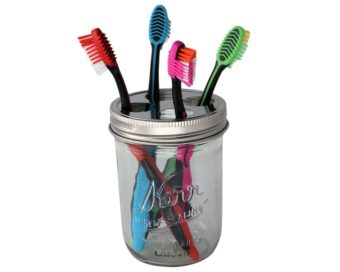 Toothbrush holder lid on wide mouth Kerr pint jar with toothbrushes
