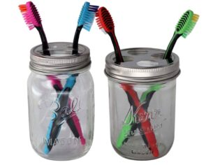 Toothbrush holder lids on wide mouth Kerr pint jar and regular mouth Ball pint jar with toothbrushes