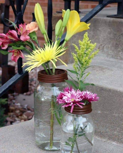 Rust / brown frog / flower organizer lids with chicken wire for regular and wide mouth Mason jars with flowers on steps