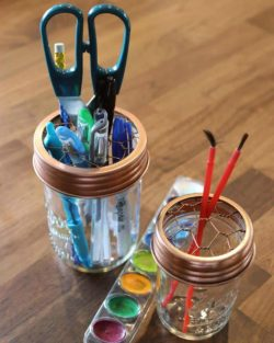 Shiny copper frog / flower / desk organizer lids for regular and wide mouth Mason jars with pens, paintbrushes, and scissors
