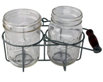 Two jar caddy with regular and wide mouth pint Ball Mason jars. Galvanized metal with wood handle.