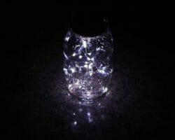 Solar light lid with 20 white LEDs in Atlas Mason jar on granite