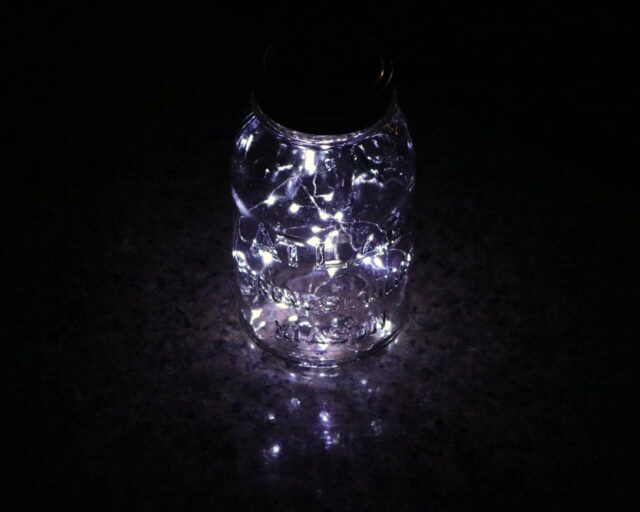 Solar light lid with 20 white LEDs in Atlas Mason jar on granite