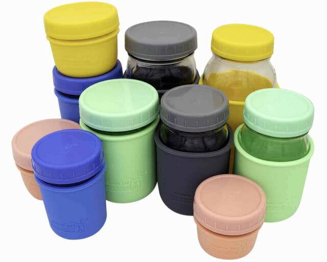 Mason Jar Lifestyle Leak proof plastic storage lids and silicone sleeves on 4oz, 8oz, 16oz, 32oz half pint quart Mason jars 5 colors